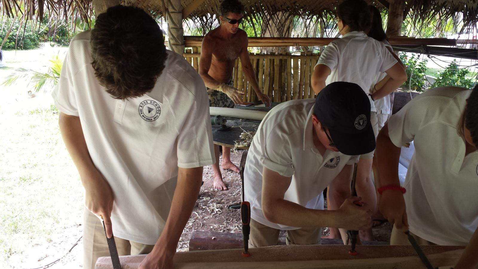 students learning traditional woodworking techniques